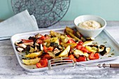 Oven-roasted vegetables with hummus