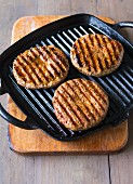 Hamburgers in a grill pan