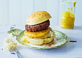 A Sunday burger with pineapple and white cabbage