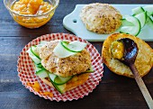 A burger with breaded mozzarella, cucumber and mango chutney