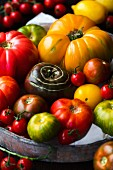Various heirloom tomatoes on a wooden tray