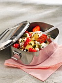 Yogurt with strawberries, pistachio nuts and breadcrumbs in a lunch box