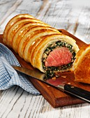 Pork fillet wrapped in puff pastry with spinach and breadcrumbs