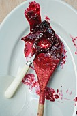 Blackberry and apple jam on a spoon