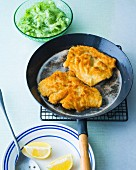 Breaded turkey escalope with cucumber salad