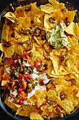 Nachos with jalapeños and sauces