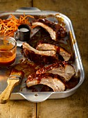 Spare ribs with a tangy honey BBQ sauce served with sweet potato fries and salt