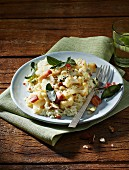 Almond risotto with cauliflower, sage, bacon and blue cheese served with lime water