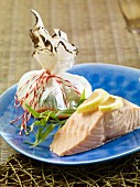 Steamed salmon with a colourful vegetables parcel