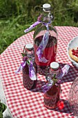 Cherryade in flip-top bottles on a checked tablecloth outside