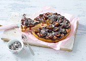 A mini damson cake with poppyseeds