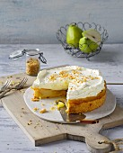 A mini cake with pears and passion fruit topped with cream