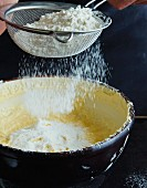 Flour being sieved