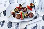 Oriental vegetables skewers with mushrooms cooked on a hot stone