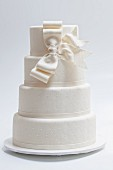 An elegant wedding cake with a white bow