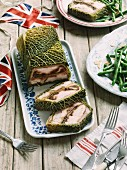 Chicken terrine with Parma ham wrapped in savoy cabbage (England)