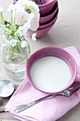 Sour soup in a purple bowl