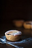 A mince pie dusted with icing sugar for Christmas