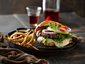 A cheeseburger with brie, onions and fried parsnips
