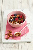 Chocolate and nut muesli with yogurt and berries