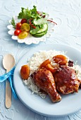 Braised chicken in a cola and tomato sauce with dried apricots and rice