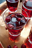 Four glasses of cranberry juice
