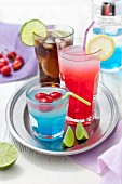 Colourful drinks with cherries, lemons and lime