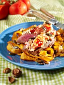 Gratinated saddle of lamb with strips of pumpkin