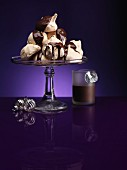 Chocolate meringues with chocolate sauce for Christmas