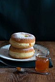 Two doughnuts with apricot jam and icing sugar