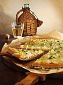 Spelt tart flambée with onions and Gouda