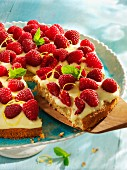 Spelt cake with lemon cream and raspberries