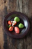 Strawberries with basil foam and red wine ice cream