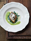 White fish fillets with league and green juniper sauce