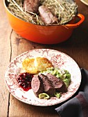 Saddle of chamois with savoy cabbage, potato cakes and cranberries