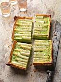 Four portions of asparagus tart