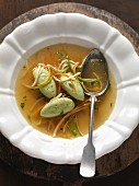 Root vegetable broth with herb dumplings
