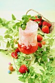 Strawberry yoghurt drink with ice cubes