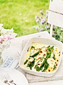 Green asparagus topped with melted cheese
