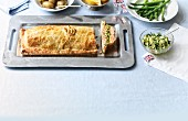 Salmon in pasty with side dishes