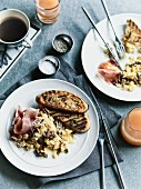 Scrambled eggs with porcini mushrooms and Parma ham for breakfast