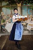 A waitress in a a Hofbräu festival tent at Oktoberfest, Munich