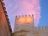 Sunset over the palace walls of the Medina of Fez, one of the four royal cities of Morocco