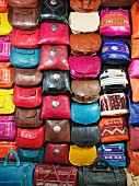 An arrangement of colourful leather handbags at a market in Fez, one of the four royal cities in Morocco