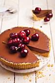 Chocolate and coffee cake with cherries