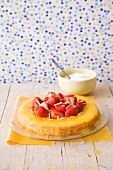 Sponge cake with strawberries with orange syrup