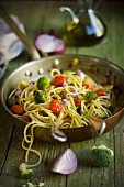 Spaghetti with turmeric vegetables and marjoram