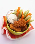 Chicken nuggets with vegetable sticks and a mayonnaise dip