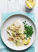 Plaice fillets with prawn in beurre blanc served with peas