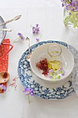 Ingredients for dishes flavoured with saffron, olive oil and edible flowers